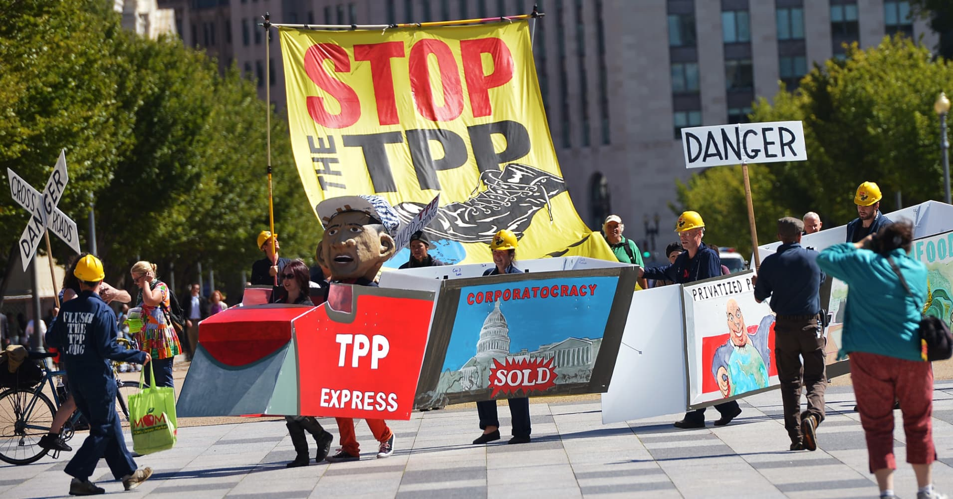 Demonstrators protesting against the Trans-Pacific Partnership are seen on Pennsylvania Avenue, in Washington, D.C.