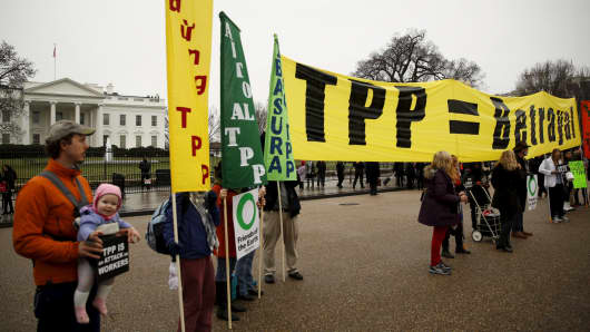 Opponents of the Trans Pacific Partnership (TPP) trade agreement protest outside of the White House in Washington February 3, 2016.