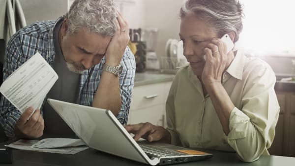 Stressed couple reviewing documents
