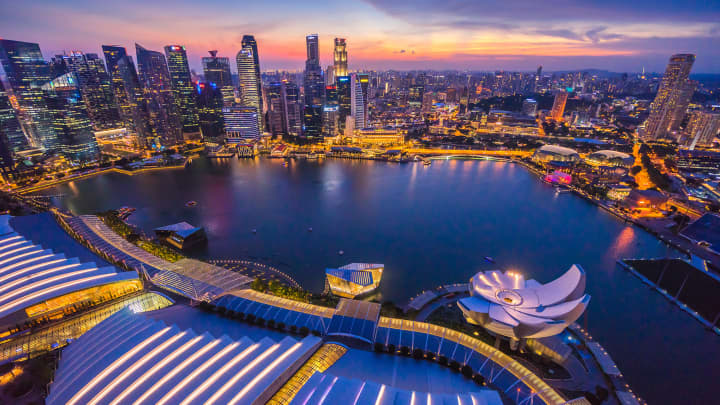 Singapore financial district at dusk.