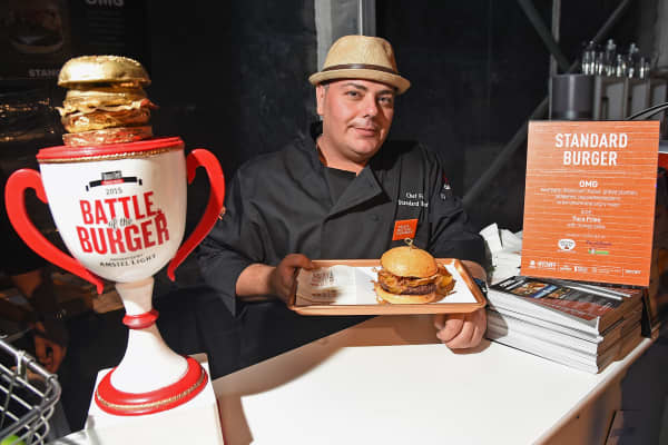 Chef Fuji of Standard Burger attends the Blue Moon Burger Bash presented by Pat LaFrieda Meats hosted by Rachael Ray - Food Network & Cooking Channel New York City Wine & Food Festival presented by FOOD & WINE at Pier 92 on October 16, 2015 in New York City.