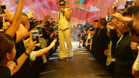 South Korean singer Psy, Park Jae-sang performs on the stage at a bar on July 18, 2015 in Hangzhou, China.
