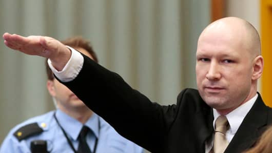 Norwegian mass killer Anders Behring Breivik makes a Nazi salute as he enters the court room in Skien prison, March 15, 2016, for his lawsuit against the Norwegian state.