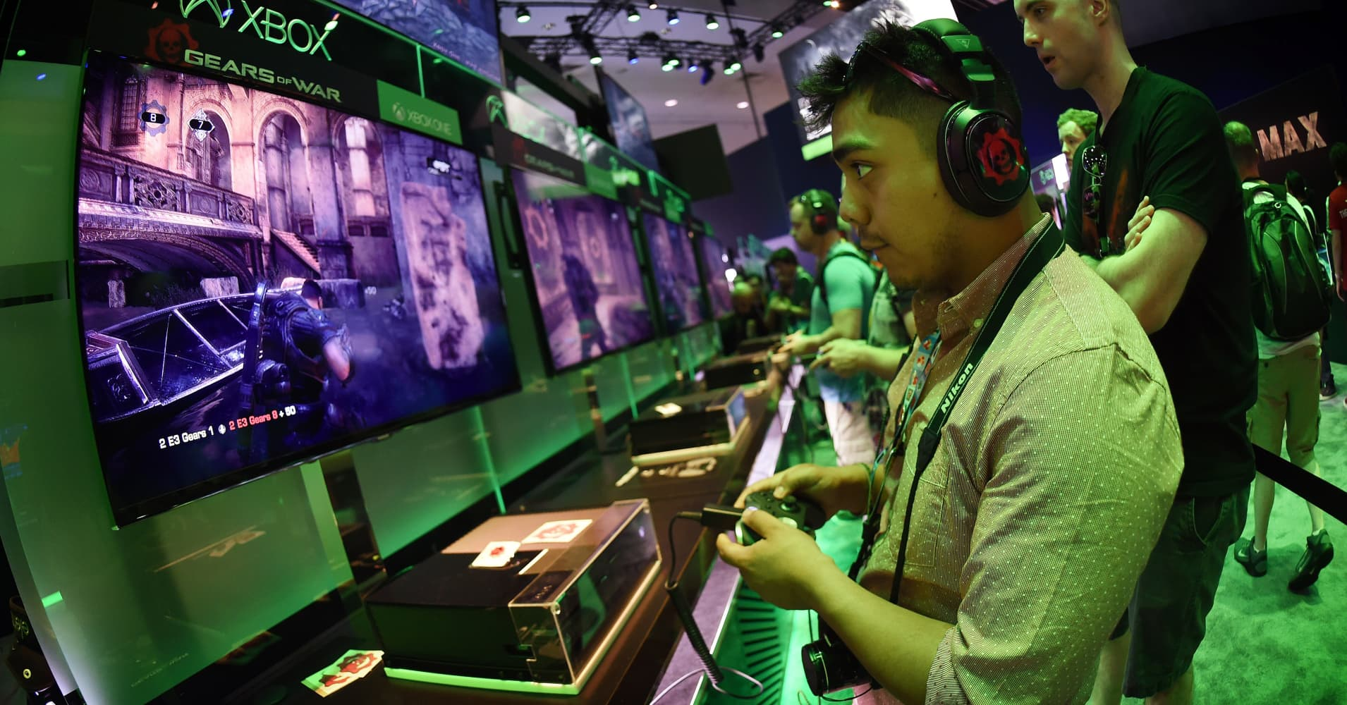 Gamers test new games at the Xbox display at the Electronic Entertainment Expo at the Convention Center in Los Angeles.
