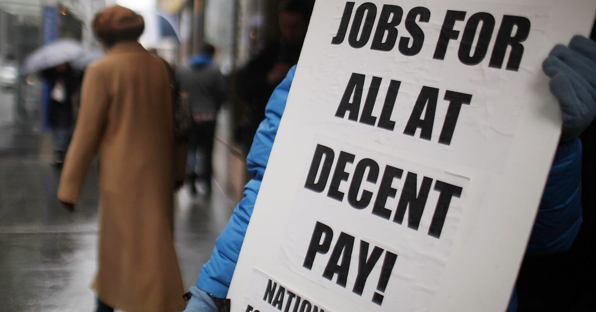 A protestor in New York City demands more jobs.