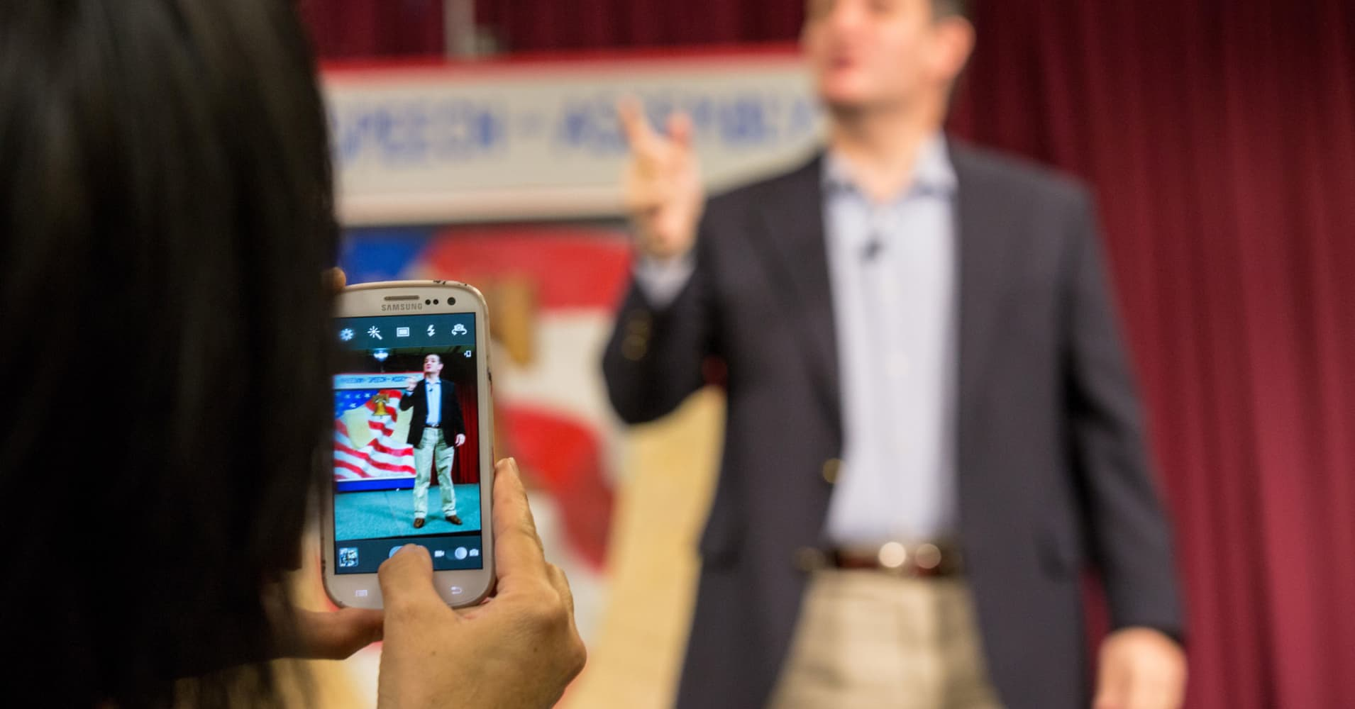 Ted Cruz speaking and seen through a mobile phone