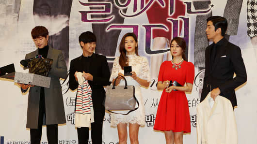 "The cast of ""My Love from the Stars"" make their appearance at a 2013 press conference. The rise of Hallyu is proving lucrative for South Korea and marketeers."