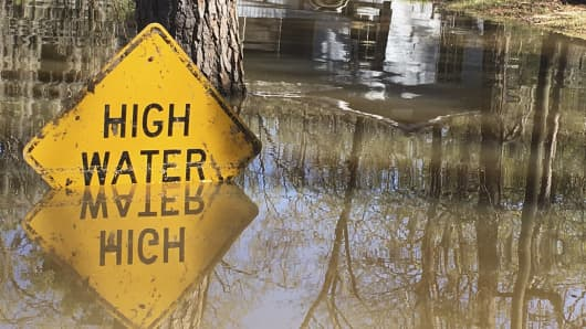 A high water sign is submerged near Lake Bistineau in Webster Parish, Louisiana March 14, 2016.