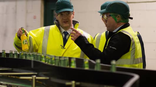 British Chancellor and Conservative MP George Osborne tours the production line during a visit to Britvic Soft Drinks Ltd on April 1, 2015 in Leeds, United Kingdom.