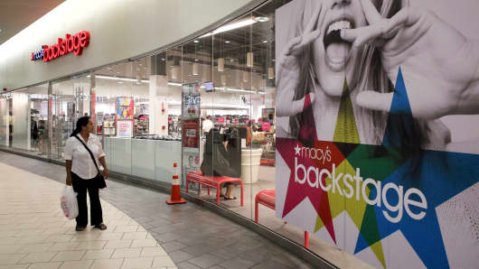 A shopper walks past the Macy's Backstage store in Queens, New York.