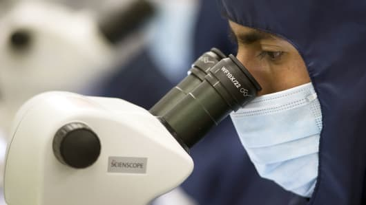 An employee uses a microscope at the Medtronic assembly plant in Tijuana, Mexico.