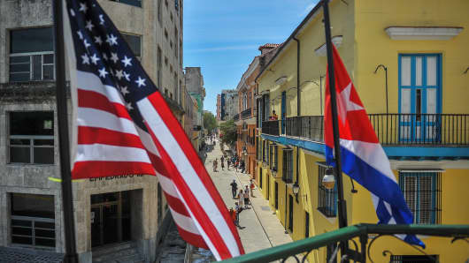 Cuban and US flags are seen outside the private restaurant La Moneda Cubana in Havana on March 17, 2016.