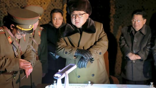 In this file photo, North Korean leader Kim Jong Un talks with officials at the ballistic rocket launch drill of the Strategic Force of the Korean People's Army (KPA) at an unknown location.