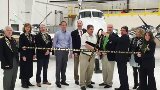A ribbon-cutting ceremony at AMRG's new aircraft maintenance facility at Ogden-Hinckley Airport.