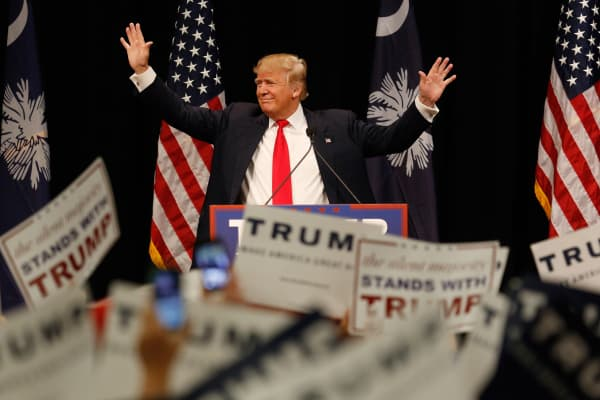 Donald Trump, president and chief executive of Trump Organization Inc. and 2016 Republican presidential candidate, acknowledges cheering audience members before speaking at a campaign rally at the Myrtle Beach Sports Center in Myrtle Beach, South Carolina, U.S., on Friday, Feb. 19, 2016.