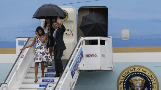 US President Barack Obama, accompanied by first lady Michelle Obama and their daughters Malia and Sasha, arrives at the Jose Marti international airport in Havana, Cuba March 20, 2016.