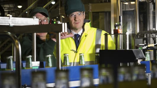Britain's Chancellor of the Exchequer George Osborne tours the Britvic manufacturing plant near Leeds in northern England April 1, 2015.