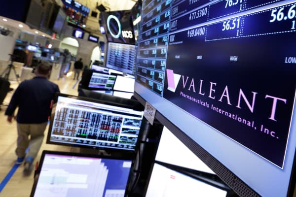 A trading post on the floor of the New York Stock Exchange displays the Valeant Pharmaceuticals logo, March 15, 2016.