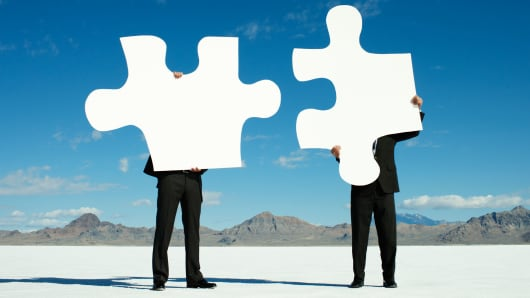 Merger breakup puzzle pieces