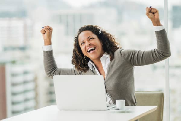 Business woman celebrating