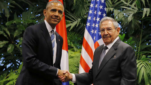 President Barack Obama and Cuba's President Raul Castro shake hands during their first meeting on the second day of Obama's visit to Cuba, in Havana March 21, 2016.