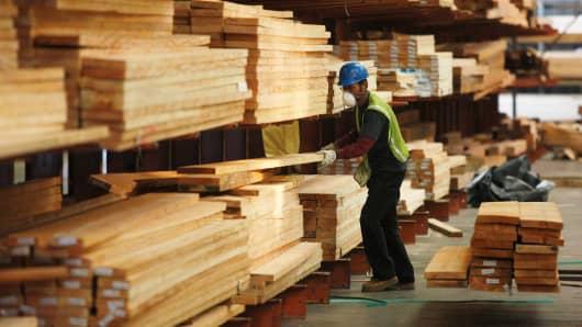 An employee in a lumber warehouse in Lynwood, California.