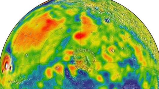 A map of Martian gravity looking down on the North Pole (center). White and red are areas of higher gravity; blue indicates areas of lower gravity