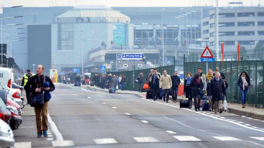 Police officers stand guard around the Zaventem Airport after two explosions went off in Brussels, Belgium on March 22, 2016.