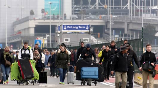 Passengers evacuated from Zaventem Bruxelles International Airport after a terrorist attack on March 22, 2016 in Brussels.