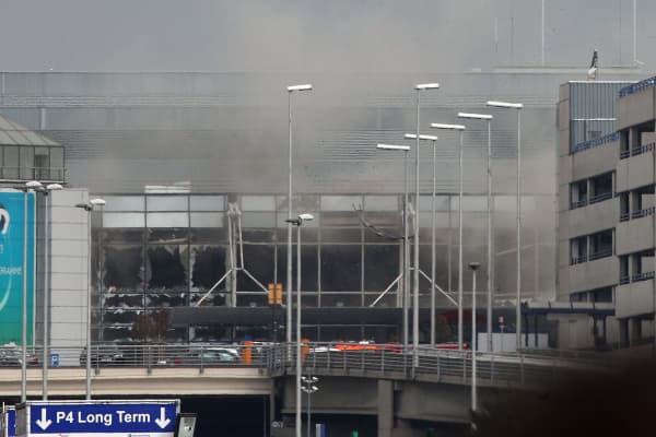 Smoke billows from the Zaventem Airport after a controlled explosion in Brussels, Tuesday, March 22, 2016. Bombs struck the Brussels airport and one of the city's metro stations Tuesday, killing and wounding dozens of people, as a European capital was again locked down amid heightened security threats.