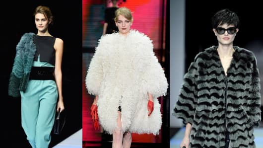 Models walk the runway at a Giorgio Armani-based show