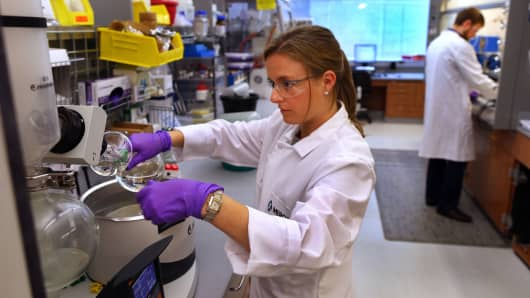 A scientist works in a Merck research lab.