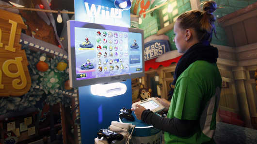 A gamer plays the video game 'Mario Kart 8' developed by Nintendo EAD on a games console Nintendo Wii U at Paris Games Week, a trade fair for video games on October 29, 2015 in Paris, France.