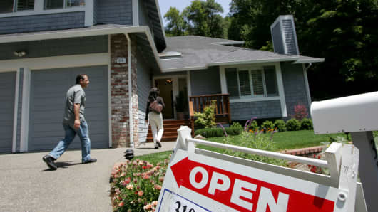 Real estate agents arrive at a brokers tour showing a house for sale in San Rafael, California.