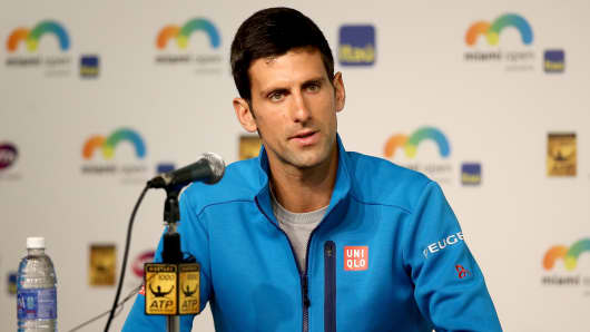 Novak Djokovic of Serbia fields questions from the media during the Miami Open.