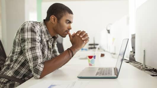 Man at computer, startup