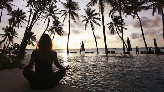 A woman does yoga at the Shangri-La's Villingili Resort and Spa Hotel in Male, Maldives.