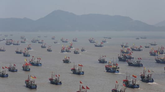 Fishing boats set off for the East China Sea from the Shipu port in Ningbo, China.
