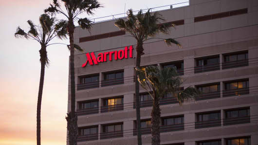 Palm trees stand in front of the Marina Del Rey Marriott hotel in Marina Del Rey, California.