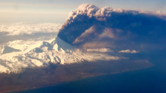In this Sunday, March 27, 2016, photo, Pavlof Volcano, one of Alaska's most active volcanoes, erupts, sending a plume of volcanic ash into the air.