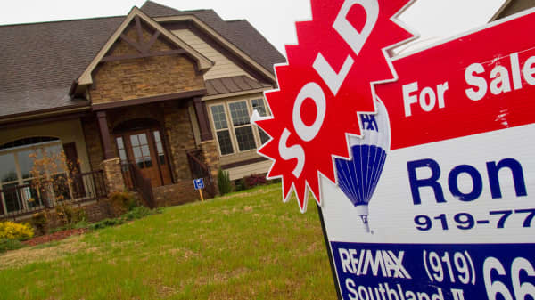 A sold sticker is displayed on a for sale sign outside a home in Garner, N.C.