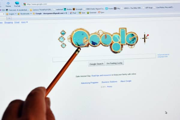 A man checks out the homepage of Google internet search engine in an office in Washington, DC, on February 8, 2011.