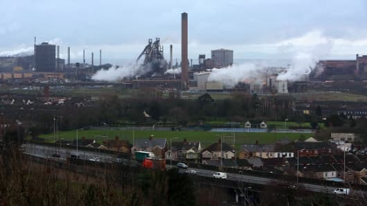 Vapor rises above Tata Steel's plant in Port Talbot, south Wales, on January 18, 2016.