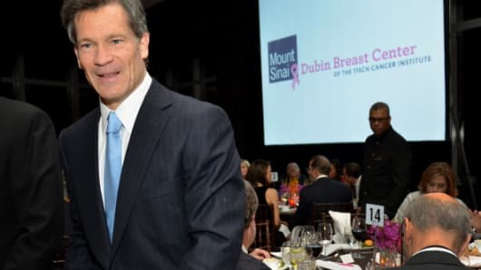 Louis Bacon, chief executive officer of Moore Capital Management LLC, speaks to an attendee during the Dubin Breast Center Gala in New York, U.S., on Monday, Dec. 12, 2011.