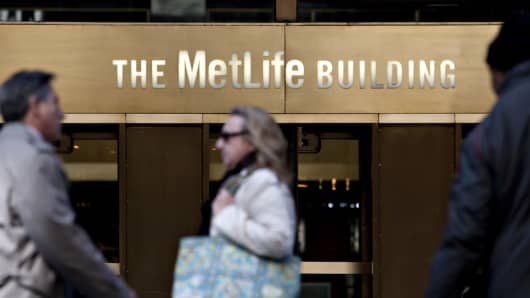 Pedestrians walk outside the MetLife building in New York.