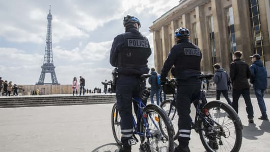A March, 2016 file photo showing police officers at the Trocadero Plaza next to the Eiffel Tower in Paris, France.