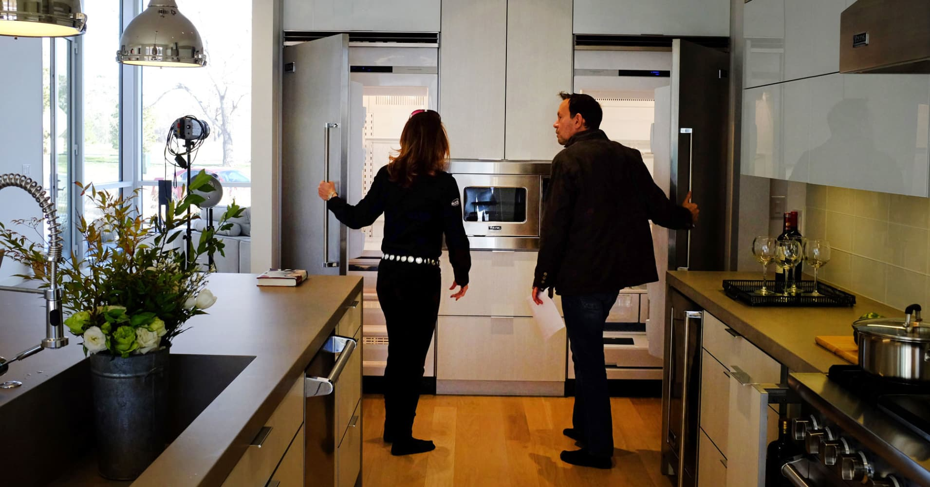 Prospective home buyers looking at a new home for sale.