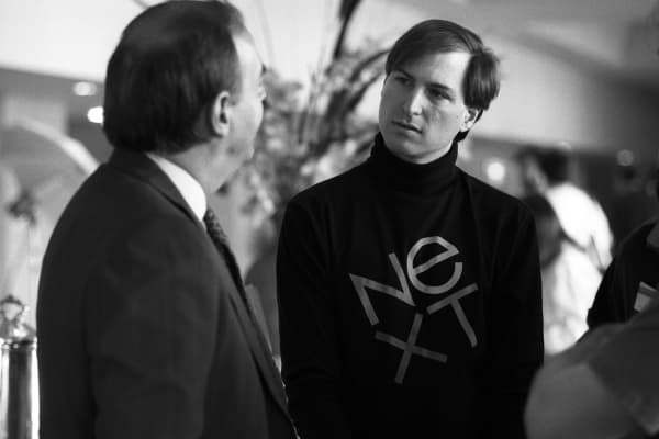 Steve Jobs wearing a NeXt shirt