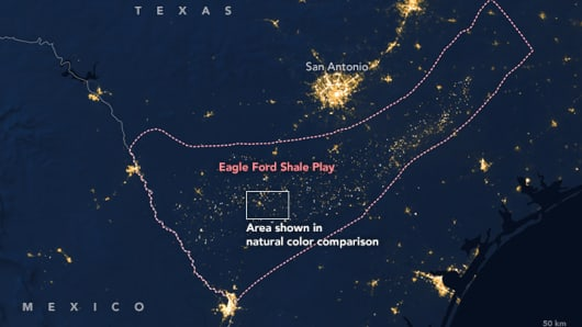 An image of the Eagle Ford shale mining site captured at night by NASA's Visible Infrared Imaging Radiometer Suite (VIIRS) on the Suomi NPP satellite. Taken on July 15, 2012.