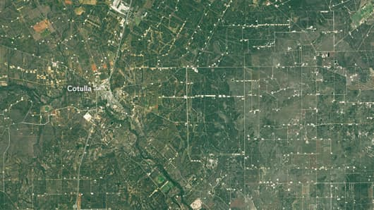 A daytime image of Cotulla, Texas, taken by Landsat 8 in 2015. The infrastructure from the wells and fracking equipment are visible.